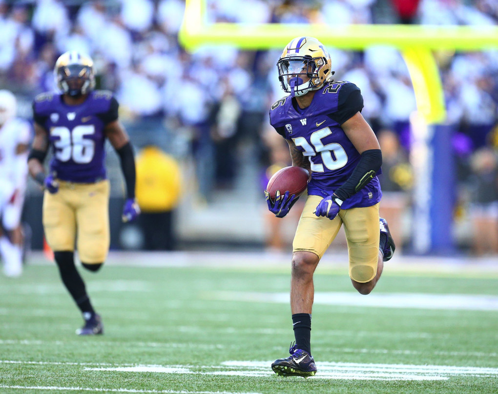 Washington's Sidney Jones returns an interception for a touchdown in the third quarter during Apple Cup at Husky Stadium Friday, Nov. 27, 2015. (JOHN LOK/THE SEATTLE TIMES / )